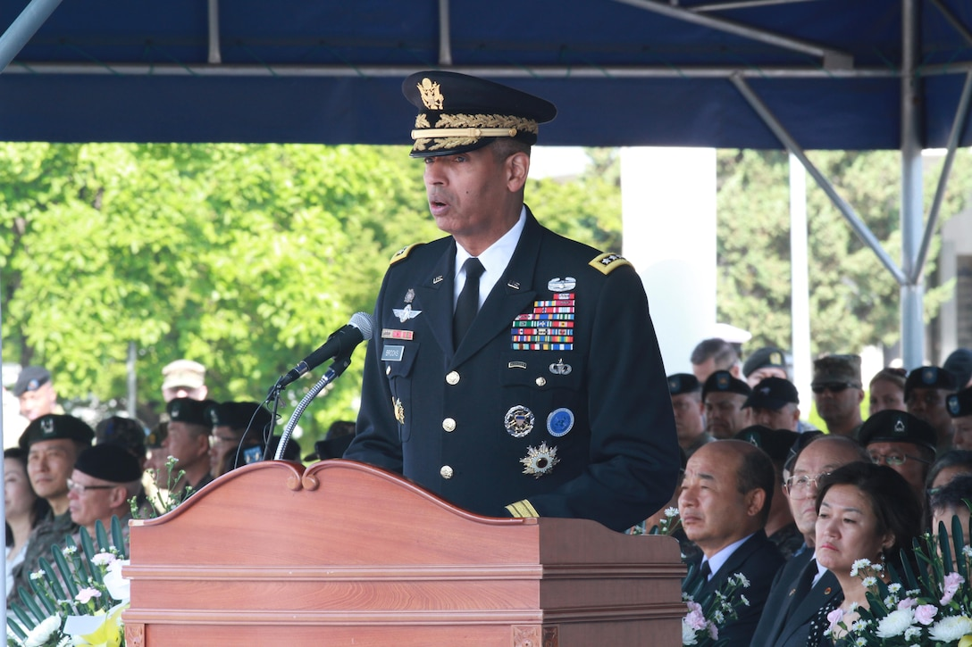"Gen. Vincent K. Brooks, United Nations Command, Combined Forces Command and United States Forces Korea commanding general, recognizes the sacrifices of U.S. and Korean service members during a Memorial Day ceremony at Knight Field, in front of the USFK headquarters near Seoul South Korea, South Korea, May 25. ""It is because of their courage that we walk unencumbered by the yoke of tyranny.  The sacrifice they and their family have made to Korea is truly profound,"" Gen. Brooks said. (U.S. Army photo by Staff Sgt. Steven Schneider)"