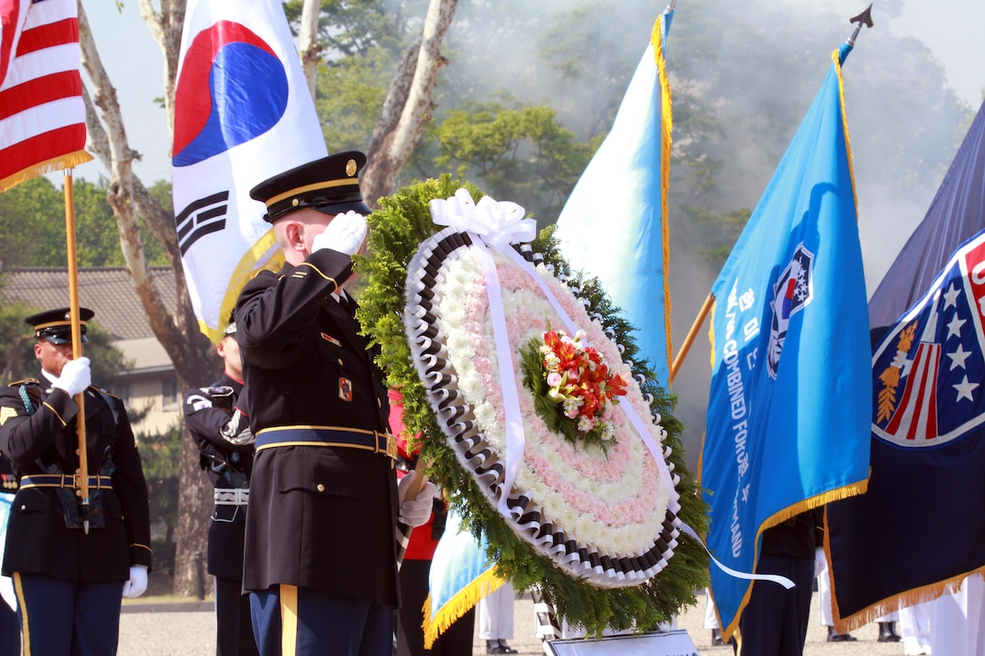 Members of the United Nations Command Honor Guard render the appropriate honors during a 21-gun salute in honor of those who have given the ultimate sacrifice in defense of the United States and Republic of Korea, during a Memorial Day ceremony at Knight Field in front of the USFK headquarters near Seoul South Korea, South Korea, May 25. The ceremony recognized all fallen service members but focused on the sacrifices made in the defense of South Korea. (U.S. Army photo by Staff Sgt. Steven Schneider, USFK Public Affairs)
