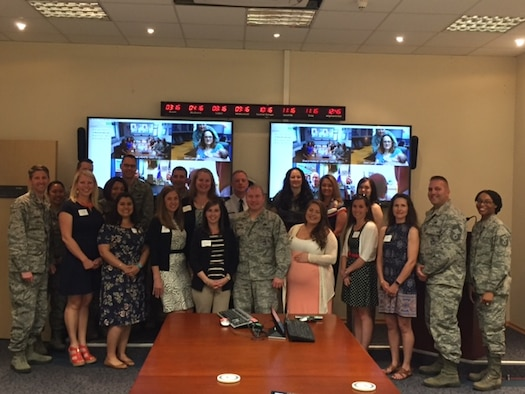 U.S. Air Force Col. Thomas Cooper, 521st Air Mobility Operations Wing commander, and 25 members of the key spouses attend a wing key spouse reception, on Ramstein Air Base, 16-May-2017. (Courtesy photo)