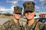 Marine Corps Pfc. Jason Gautreaux, left, and his brother, Marine Corps Lance Cpl. Mitch Gautreaux, take a picture together after training at the School of Infantry at Marine Corps Base Camp Geiger, N.C., Nov. 23, 2016. Both Marines will soon be assigned to units in close proximity to one another after graduating from Squadron Intelligence Training Certification Course. Jason will be assigned to Marine Light Attack Helicopter Squadron 267 at Marine Corps Base Camp Pendleton, Calif., and Mitch will be assigned to Marine Heavy Helicopter Squadron 465 at Marine Corps Air Station Miramar, Calif. Courtesy photo