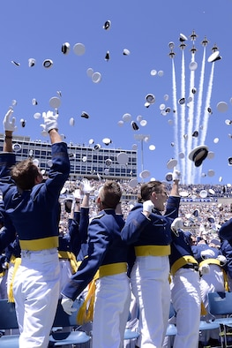 Newly-commissioned Air Force officers toss their hats in the air as the Air Force Thunderbirds fly over Falcon Stadium, May 24, 2017, at the end of the U.S. Air Force Academy's Class of 2017 graduation ceremony. (U.S. Air Force photo/Mike Kaplan)