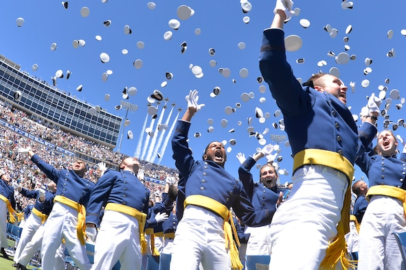 Newly-minted Air Force second lieutenants toss their hats in the air at the end of the Class of 2017 graduation ceremony, May 24, 2017, at the U.S. Air Force Academy (U.S. Air Force photo/Bill Evans)