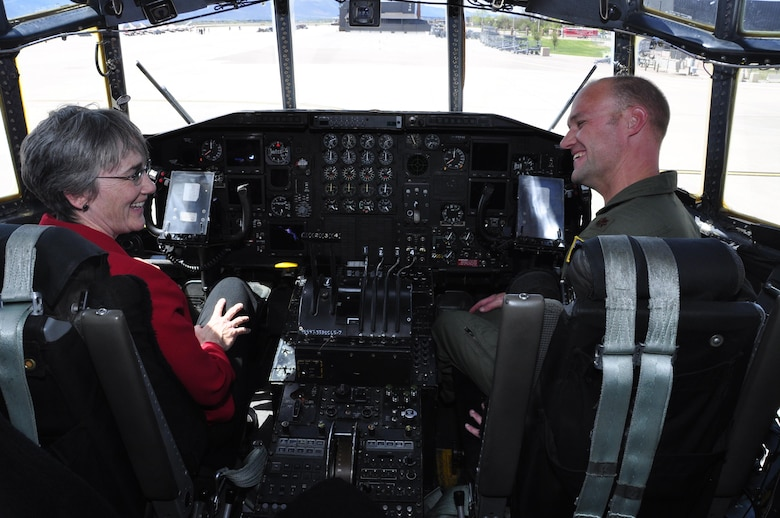 Secretary of the Air Force Heather Wilson, talks with Maj. Joseph Bennington, on the flight deck of an Air Force Reserve C-130 Hercules during her visit to Peterson Air Force Base, Colo., May 22, 2017. Bennington is a C-130 instructor pilot assigned to the 302nd Operations Support Squadron. Peterson AFB was the first official base visit for Wilson as Secretary of the Air Force. (U.S. Air Force photo/Staff Sgt. Frank Casciotta)