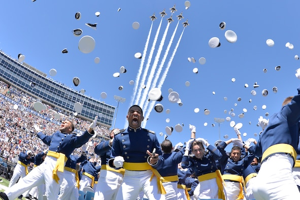 Newly-minted Air Force second lieutenants cheer and toss their hats at the end of the U.S. Air Force Academy's Class of 2017 graduation ceremony, May 24, 2017, at Falcon Stadium. (U.S. Air Force photo/Bill Evans)