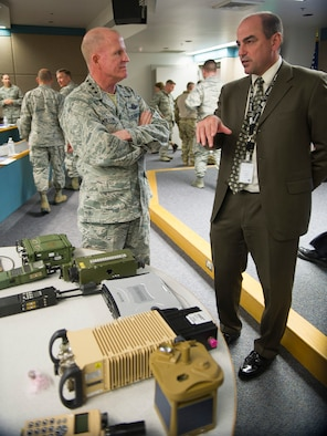Gen. Stephen Wilson, Air Force vice chief of staff, talks with Paul Hrosch, Air Force Life Cycle Management Center's Intelligence, Surveillance and Reconnaissance and Special Operations Forces Directorate Battlefield Airman Branch chief engineer, May 10, 2017, at Wright-Patterson Air Force Base, Ohio,. Wilson was briefed on new equipment being developed for Battlefield Airmen. (U.S. Air Force photo by R.J. Oriez)