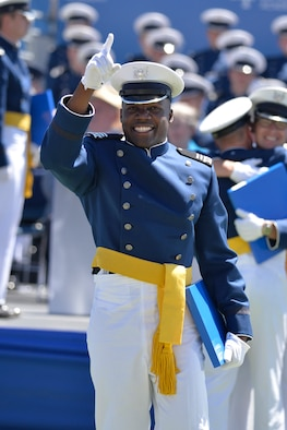 Newly-minted 2nd Lt. Haji Dunn points to the sky after receiving his diploma during the U.S. Air Force Academy's Class of 2017 graduation ceremony, May 24, 2017, in Falcon Stadium. (U.S. Air Force photo/Bill Evans)