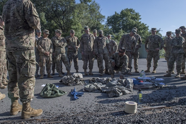 Tech. Sgt. Jose Deleon, 820th Combat Operations Squadron NCO in charge of deployed radio frequency systems and lead assessment instructor, demonstrates how to properly lay out mandatory items for an inspection during a Army Air Assault assessment, May 16, 2017, at Moody Air Force Base, Ga. Twenty-six Airmen attended the assessment which measured candidates' aptitude in Air Assault operations, completion of equipment layouts, and rappelling. (U.S. Air Force photo by Tech. Sgt. Zachary Wolf)