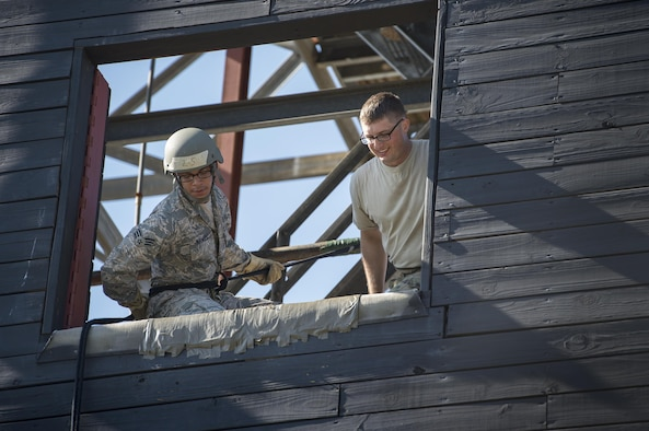 Senior Airman Steven Morales, 45th Security Forces patrolman from Patrick Air Force Base, Fla., prepares to rappel during an Army Air Assault assessment, May 17, 2017, at Moody Air Force Base, Ga. Twenty-six Airmen attended the assessment which measured candidates' aptitude in Air Assault operations, completion of equipment layouts, and rappelling. (U.S. Air Force photo by Tech. Sgt. Zachary Wolf)