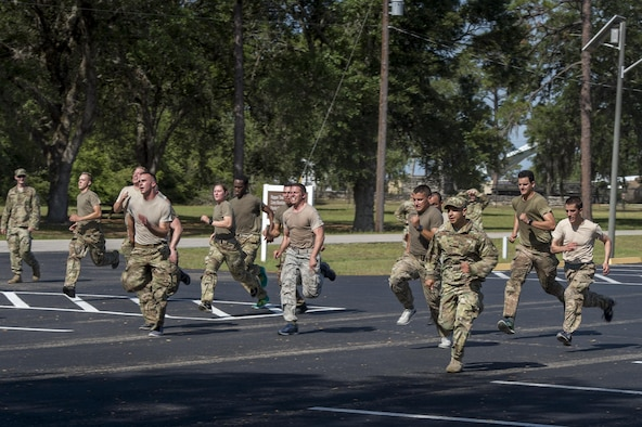 Army Air Assault candidates run during a calisthenics session at an Army Air Assault assessment, May 18, 2017, at Camp Blanding, Fla. Twenty-six Airmen attended the assessment which measured candidates' aptitude in Air Assault operations, completion of equipment layouts, and rappelling. (U.S. Air Force photo by Tech. Sgt. Zachary Wolf)