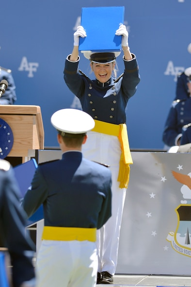 Newly-commissioned 2nd Lt. Lily Forlini holds up her diploma during the U.S. Air Force Academy's Class of 2017 graduation ceremony, May 25, 2017, at Falcon Stadium. (U.S. Air Force photo/Bill Evans)