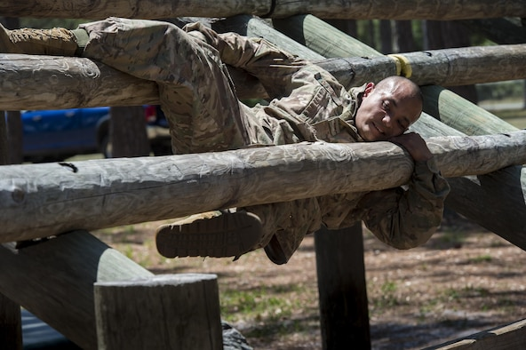 Staff Sgt. Adrian De Dios, 822nd Base Defense Squadron fire team leader, attempts a weaver obstacle during an Army Air Assault assessment, May 18, 2017, at Camp Blanding, Fla. Twenty-six Airmen attended the assessment which measured candidates' aptitude in Air Assault operations, completion of equipment layouts, and rappelling. (U.S. Air Force photo by Tech. Sgt. Zachary Wolf)