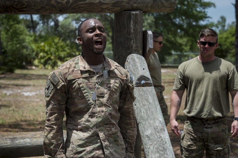 Airman Montrease Tinson, 822nd Base Defense Squadron fire team member, sounds-off after completing an obstacle during an Army Air Assault assessment, May 18, 2017, at Camp Blanding, Fla. Twenty-six Airmen attended the assessment which measured candidates' aptitude in Air Assault operations, completion of equipment layouts, and rappelling. (U.S. Air Force photo by Tech. Sgt. Zachary Wolf)