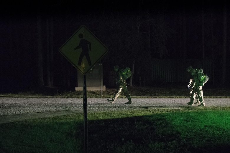 Army Air Assault candidates begin a 12-mile ruck march during an Army Air Assault Assessment, May 19, 2017, at Moody Air Force Base, Ga. Twenty-six Airmen attended the assessment which measured candidates' aptitude in Air Assault operations, completion of equipment layouts, and rappelling. (U.S. Air Force photo by Tech. Sgt. Zachary Wolf)
