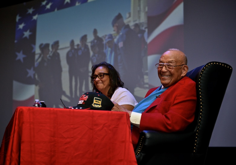Tuskegee Airman, retired Lt. Col. Robert (Bob) J. Friend gives the audience a great smile as he finishes a presentation May 7, 2017 at the Scott Library Auditorium, Scott Air Force Base, Illinois. Seated with Friend is Karen Friend Crumlich, one of his daughters and assistant when he travels to various speaking engagements. (U.S. Air Force photo by Tech. Sgt. Christopher Parr)