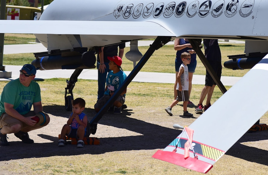 Veterans and their families admire the MQ-1 Predator during the American Patriot Festival May 20, 2017, in Las Vegas. The American Patriot Festival brought veterans and their families together to enjoy military displays, performances and a car show. (U.S. Air Force photo/Senior Airman Christian Clausen)