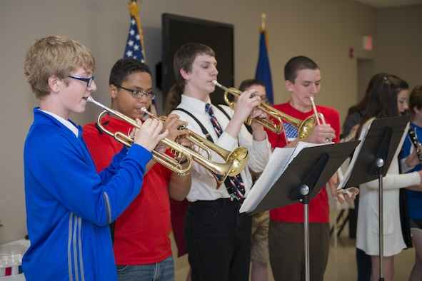 The Newfane Middle School band performs during a military luncheon hosted by Newfane Elementary and Middle Schoolers, May 24, 2017, community center, Newfane, N.Y. The luncheon was open to veterans and actively serving Military members. The children sang songs and played music, then went on to serve lunch to those in attendance. (U.S. Air Force photo by Tech. Sgt. Stephanie Sawyer)