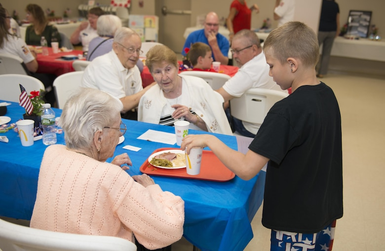 Newfane Elementary and Middle Schoolers host a military luncheon for veterans and actively serving military members, May 24, 2017, community center, Newfane, N.Y. The children sang songs and played music, then went on to serve lunch to those in attendance. (U.S. Air Force photo by Tech. Sgt. Stephanie Sawyer)