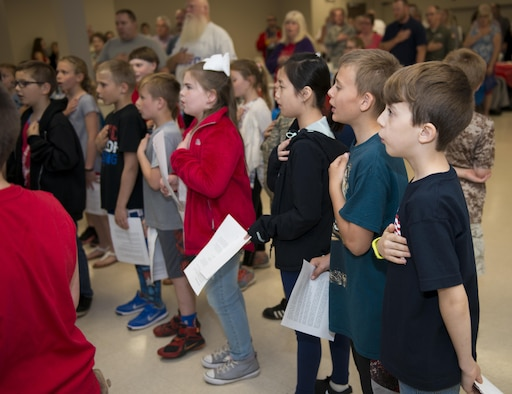 Children from Newfane Elementary School recite the pledge of allegiance during a military luncheon hosted by the students, May 24, 2017, community center, Newfane, N.Y. The luncheon was open to veterans and actively serving Military members. The children sang songs and played music, then went on to serve lunch to those in attendance. (U.S. Air Force photo by Tech. Sgt. Stephanie Sawyer)