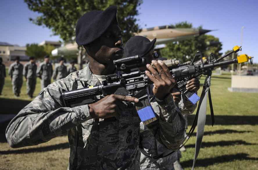 Senior Airman Anthony Flynn, 99th Security Forces Squadron leader, performs a 21 gun salute to honor fallen law enforcement officers during a ceremony for National Police Week at Nellis Air Force Base, Nev., May 19, 2017. Throughout the week, Defenders and local law enforcement participated in a variety of events at Nellis and Creech AFB. (U.S. Air Force photo by Senior Airman Kevin Tanenbaum/Released)