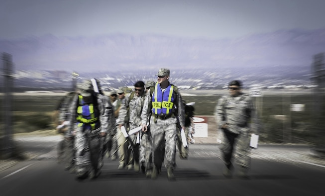 Defenders from the 99th and 799th Security Forces Squadrons participate in a ruck march during National Police Week at Nellis Air Force Base, Nev. May 16, 2017. Defenders, along with local law enforcement used the week to come together in a series of events to commemorate. (U.S. Air Force photo by Senior Airman Kevin Tanenbaum/Released)