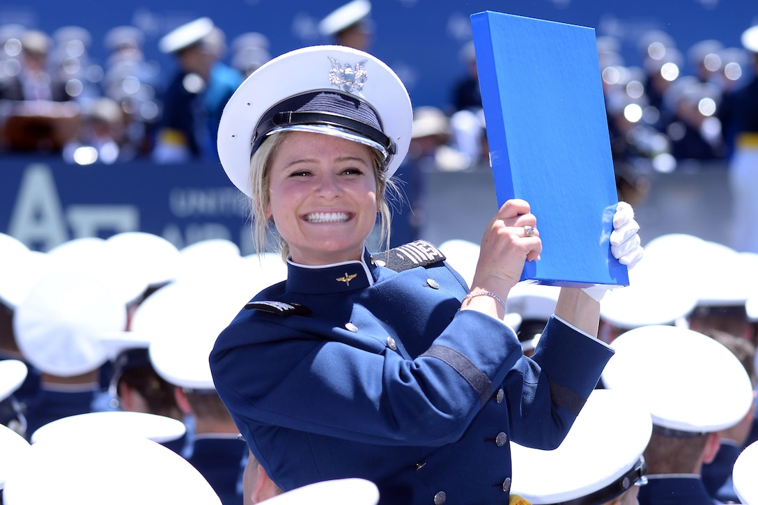 Second Lt. Chloe Forlini holds her diploma after graduating with the U.S. Air Force Academy's Class of 2017, May 24, 2017, at Falcon Stadium. (U.S. Air Force photo/Jason Gutiarrez)