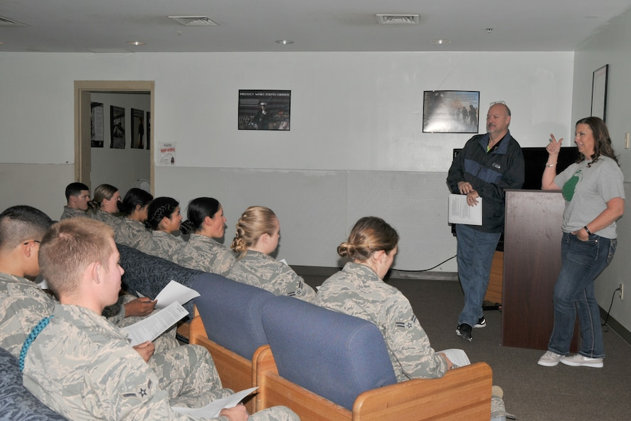 David Sullins, 17th Training Wing community support coordinator, and Megan Fowler, 17th Training Wing Green Dot coordinator, discuss responsible drinking habits with strudents from the 315th Training Squadron at the Marine Corps Detatchment on Goodfellow Air Force Base, Texas, May 25, 2017. The facilitators encouraged the students to share their experiences and provide tips on how to drink responsibly. (U.S. Air Force photo by Airman 1st Class Randall Moose/Released)