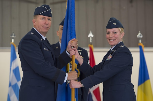 Maj. Gen. Patrick Doherty, 19th Air Force commander, passes the ceremonial guidon to Col. Andrea Themely, incoming 80th Flying Training Wing commander, during the 80th Flying Training Wing Change of Command ceremony at Sheppard Air Force Base, Texas, May 25, 2017. Themely previously served at Sheppard as commander of the 89th Flying Training Squadron from 2012 to 2014. (U.S. Air Force photo by Staff Sgt. Kyle E. Gese)