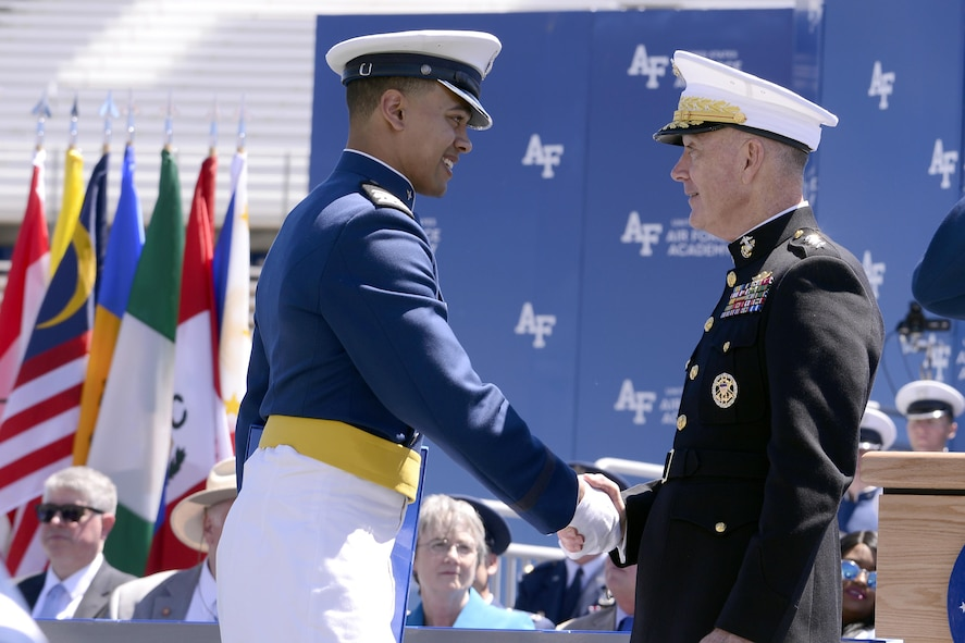 Newly-commissioned 2nd Lt. Brodie Hicks shakes hands with Chairman of the Joint Chiefs of Staff Marine Gen. Joseph Dunford during the U.S. Air Force Academy's Class of 2017 Graduation Ceremony at Falcon Stadium, May 24, 2017. (Air Force photo/ Mike Kaplan)