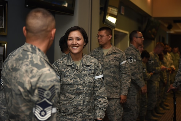 U.S. Air Force Master Sgt. selects wait in line to be announced during the Master Sergeant Release Party at the Event Center on Goodfellow Air Force Base, Texas, May 24, 2017. The selects were requested to wear master sergeant stripes over their ranks during the party. (U.S. Air Force photo by Airman 1st Class Caelynn Ferguson/ Released)