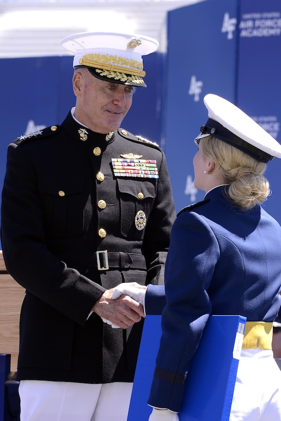 Newly-commissioned 2nd Lt.Darby Germain shakeS hands with Chairman of the Joint Chiefs of Staff Marine Gen. Joseph Dunford during the U.S. Air Force Academy's Class of 2017 Graduation Ceremony at Falcon Stadium, May 24, 2017. (Air Force photo/ Mike Kaplan)