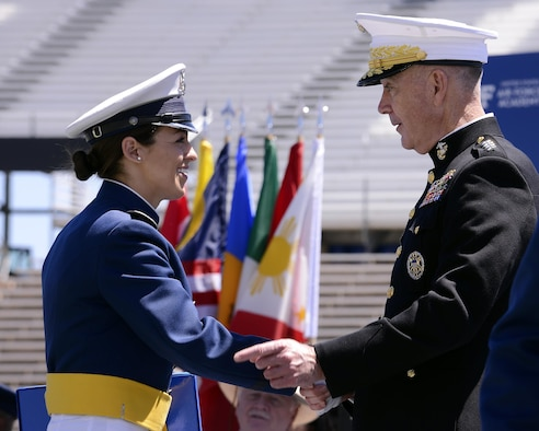 Newly-commissioned 2nd Lt. Marlene Flescher shakes hands with Chairman of the Joint Chiefs of Staff Marine Gen. Joseph Dunford during the U.S. Air Force Academy's Class of 2017 Graduation Ceremony at Falcon Stadium, May 24, 2017. (U.S. Air Force photo/ Mike Kaplan)