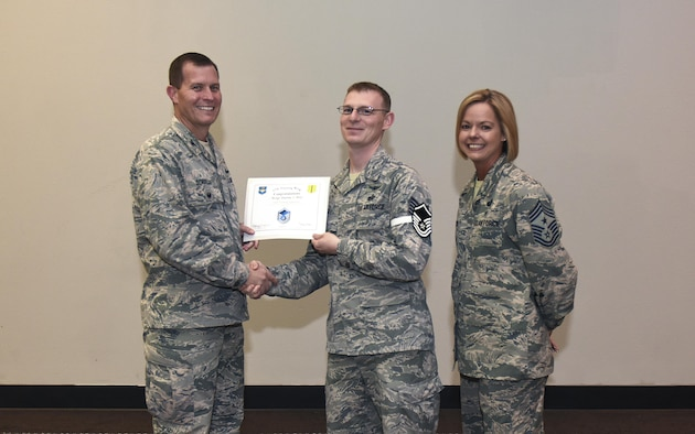 U.S. Air Force Master Sgt. select Andrew Britt, 316th Training Squadron, receives his certificate of selection from Col. Jeffrey Sorrell, 17th Training Wing vice commander, and Chief Master Sergeant Bobbie Riensche, 17th Training Wing command chief, during the Master Sergeant Release Party at the Event Center on Goodfellow Air Force Base, Texas, May 24, 2017.