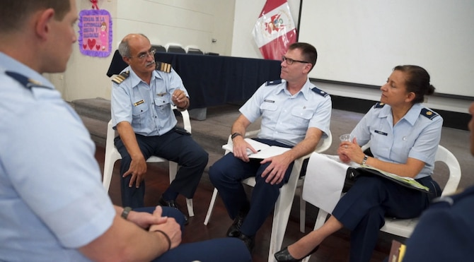 U.S. Air Force Lt. Col. Mark Breidenbaugh, 757th Airlift Squadron entomologist, Youngstown Air Reserve Station, Ohio, and U.S. Air Force Major Helda Carey, 12th Air Force International Health Specialist, participate in a discussion with Peruvian medical personnel during a subject matter expert exchange in Lima, Peru, May 17, 2017.  The goal of the global health exchange is to share best practices, enhance relationships, and build partnership capacities.(U.S. Air Force photo by Staff Sgt. Danny Rangel)