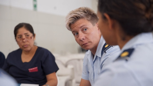 U.S. Air Force Major Jodi Pritchard, 167th Aeromedical Squadron Flight Nurse, West Virginia Air National Guard, Charleston, West Virginia, participates in a discussion with Peruvian medical personnel during a subject matter expert exchange in Lima, Peru, May 17, 2017.  The goal of the global health exchange is to share best practices, enhance relationships, and build partnership capacities. (U.S. Air Force photo by Danny Rangel)