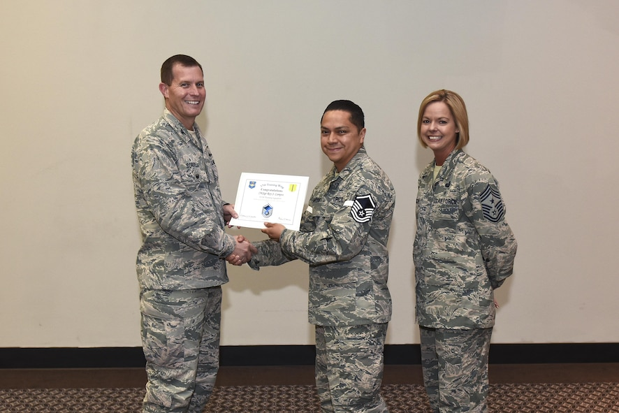 U.S. Air Force Master Sgt. select Roy Campos, 312th Training Squadron, receives his certificate of selection from Col. Jeffrey Sorrell, 17th Training Wing vice commander, and Chief Master Sergeant Bobbie Riensche, 17th Training Wing command chief, during the Master Sergeant Release Party at the Event Center on Goodfellow Air Force Base, Texas, May 24, 2017.