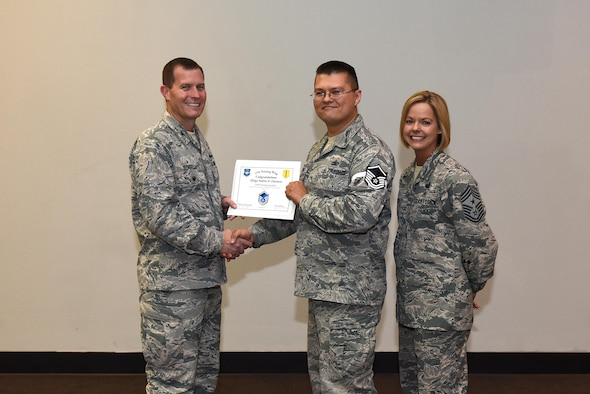 U.S. Air Force Master Sgt. select Andrew Claremont, 316th Training Squadron, receives his certificate of selection from Col. Jeffrey Sorrell, 17th Training Wing vice commander, and Chief Master Sergeant Bobbie Riensche, 17th Training Wing command chief, during the Master Sergeant Release Party at the Event Center on Goodfellow Air Force Base, Texas, May 24, 2017.
