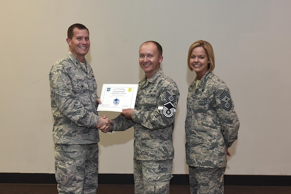 U.S. Air Force Master Sgt. select Aaron Dvorak, 315th Training Squadron, receives his certificate of selection from Col. Jeffrey Sorrell, 17th Training Wing vice commander, and Chief Master Sergeant Bobbie Riensche, 17th Training Wing command chief, during the Master Sergeant Release Party at the Event Center on Goodfellow Air Force Base, Texas, May 24, 2017.