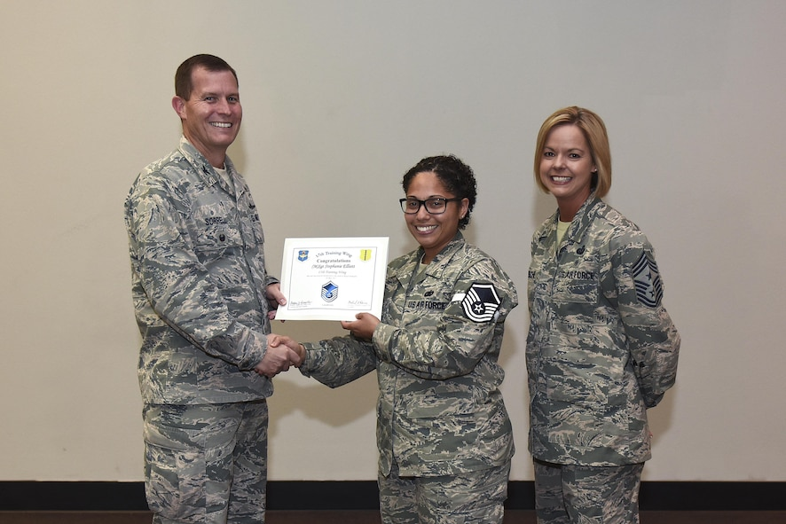 U.S. Air Force Master Sgt. select Stephanie Elliot, 17th Training Wing, receives her certificate of selection from Col. Jeffrey Sorrell, 17th Training Wing vice commander, and Chief Master Sergeant Bobbie Riensche, 17th Training Wing command chief, during the Master Sergeant Release Party at the Event Center on Goodfellow Air Force Base, Texas, May 24, 2017.