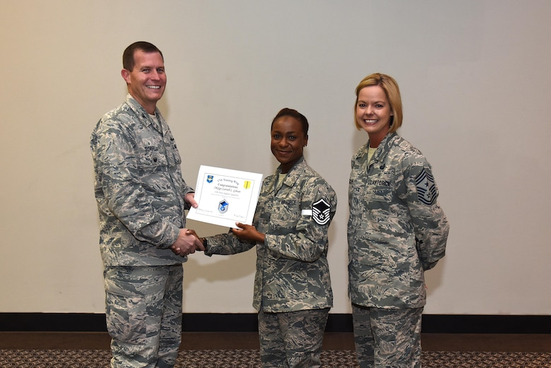 U.S. Air Force Master Sgt. select Curtrell Gibson, 17th Force Support Squadron, receives her certificate of selection from Col. Jeffrey Sorrell, 17th Training Wing vice commander, and Chief Master Sergeant Bobbie Riensche, 17th Training Wing command chief, during the Master Sergeant Release Party at the Event Center on Goodfellow Air Force Base, Texas, May 24, 2017.