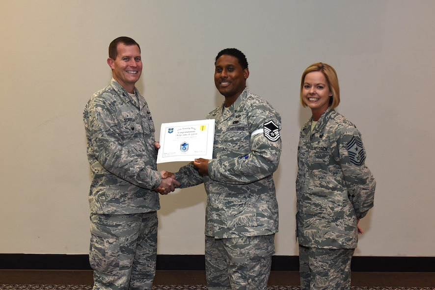U.S. Air Force Master Sgt. select James Gipson, 17th Force Support Squadron, receives his certificate of selection from Col. Jeffrey Sorrell, 17th Training Wing vice commander, and Chief Master Sergeant Bobbie Riensche, 17th Training Wing command chief, during the Master Sergeant Release Party at the Event Center on Goodfellow Air Force Base, Texas, May 24, 2017.