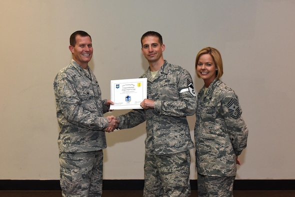 U.S. Air Force Master Sgt. select Joseph King, 312th Training Squadron, receives his certificate of selection from Col. Jeffrey Sorrell, 17th Training Wing vice commander, and Chief Master Sergeant Bobbie Riensche, 17th Training Wing command chief, during the Master Sergeant Release Party at the Event Center on Goodfellow Air Force Base, Texas, May 24, 2017.