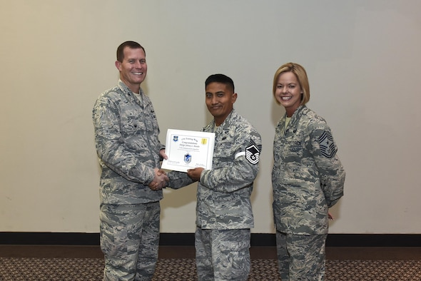 U.S. Air Force Master Sgt. select Johnny Patubo, 17th Communications Squadron, receives his certificate of selection from Col. Jeffrey Sorrell, 17th Training Wing vice commander, and Chief Master Sergeant Bobbie Riensche, 17th Training Wing command chief, during the Master Sergeant Release Party at the Event Center on Goodfellow Air Force Base, Texas, May 24, 2017.