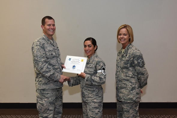 U.S. Air Force Master Sgt. select Rosanna Surber, 17th Comptroller Squadron, receives her certificate of selection from Col. Jeffrey Sorrell, 17th Training Wing vice commander, and Chief Master Sergeant Bobbie Riensche, 17th Training Wing command chief, during the Master Sergeant Release Party at the Event Center on Goodfellow Air Force Base, Texas, May 24, 2017.