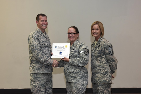 U.S. Air Force Master Sgt. select Jessica Turner, 17th Communications Squadron, receives her certificate of selection from Col. Jeffrey Sorrell, 17th Training Wing vice commander, and Chief Master Sergeant Bobbie Riensche, 17th Training Wing command chief, during the Master Sergeant Release Party at the Event Center on Goodfellow Air Force Base, Texas, May 24, 2017.