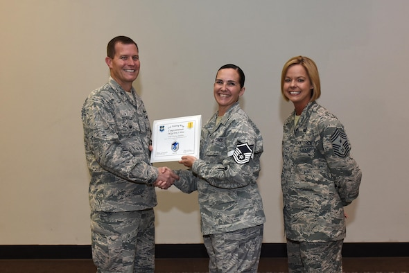 U.S. Air Force Master Sgt. select Erin Weiss, 316th Training Squadron, receives her certificate of selection from Col. Jeffrey Sorrell, 17th Training Wing vice commander, and Chief Master Sergeant Bobbie Riensche, 17th Training Wing command chief, during the Master Sergeant Release Party at the Event Center on Goodfellow Air Force Base, Texas, May 24, 2017.