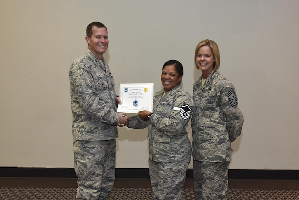 U.S. Air Force Master Sgt. select Chanelle Wilburn, 17th Force Support Squadron, receives her certificate of selection from Col. Jeffrey Sorrell, 17th Training Wing vice commander, and Chief Master Sergeant Bobbie Riensche, 17th Training Wing command chief, during the Master Sergeant Release Party at the Event Center on Goodfellow Air Force Base, Texas, May 24, 2017.
