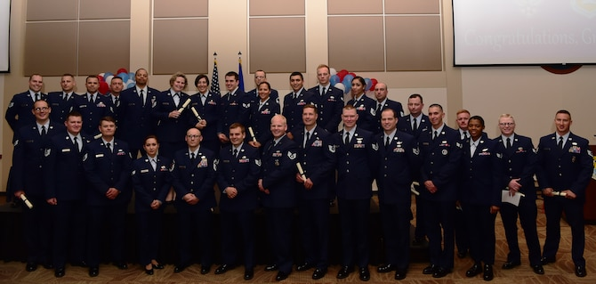 Airmen from Buckley Air Force Base graduated from The Community College of the Air Force, May 24, in a ceremony at the Leadership Development Center here. (U.S. Air Force photo by Airman 1st Class Jessica Huggins)