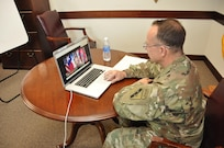 "In this image released by the Army Reserve's 75th Training Command, Maj. Gen. James ""Boe"" Young, the unit's commanding general, addresses Soldiers and others as part of a live video ""town hall"" in Houston, Texas, Saturday, May 20, 2017. The unit chose the format partly due to the organization's geographic footprint. While headquartered in Houston, its subordinate units are located across the country, so the Facebook-hosted event provided an effective way to connect with those troops. Reserve units historically have had to look for creative ways to provide support and communication for its troops and family members, who often are not located near active duty bases where such support functions are readily available to the full-time force. (Photo/75th Training Command, Army Reserve Lt. Col. Adam Collett)"