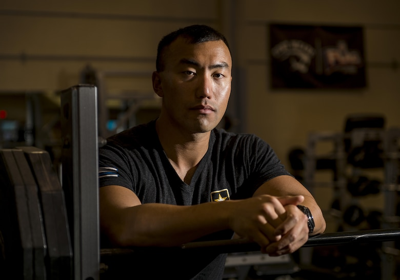 Sgt. 1st Class Jason Lee, a U.S. Army Reserve Soldier from the 200th Military Police Command and a certified Master Fitness Trainer, poses for a portrait during a Performance Triad program organized by him, hosted on Fort Meade, Maryland, May 12, 2017. The three-week fitness program took place from May 5-25 to help Soldiers who had either failed the Army Physical Fitness Test or had been on the Army Body Fat Composition program. The camp focused on the triad of overall health: physical fitness, nutrition and sleep, by providing education and personalized coaching to Soldiers in all three of those phases of life and more. (U.S. Army Reserve photo by Master Sgt. Michel Sauret)