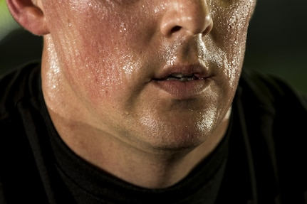 Sweat drips down the face of a U.S. Army Reserve Soldier from the 200th Military Police Command during a Spin class as part of a Performance Triad program organized by the command and hosted on Fort Meade, Maryland, May 9, 2017. The three-week fitness program took place from May 5-25 to help Soldiers who had either failed the Army Physical Fitness Test or had been on the Army Body Fat Composition program. The camp focused on the triad of overall health: physical fitness, nutrition and sleep, by providing education and personalized coaching to Soldiers in all three of those phases of life and more. (U.S. Army Reserve photo by Master Sgt. Michel Sauret)